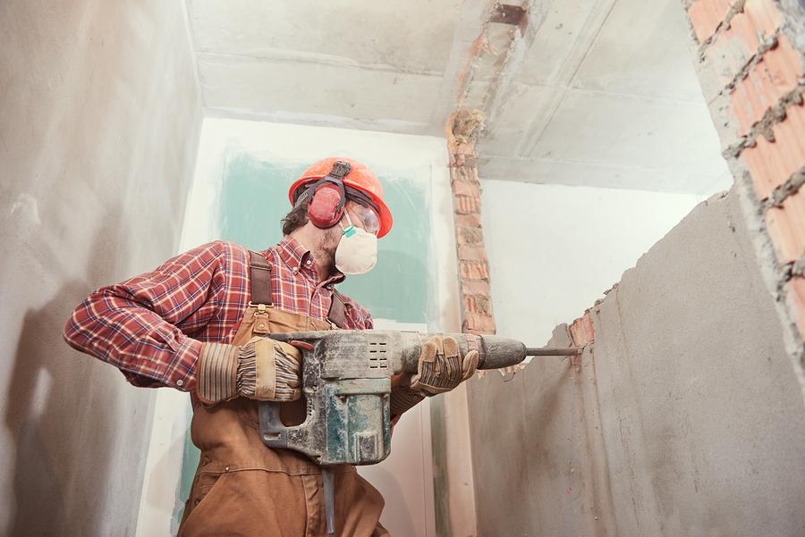 man demolish the house